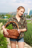 Girl in jeans shorts with basket Royalty Free Stock Images