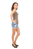 Girl in jeans shorts, full length Stock Photos