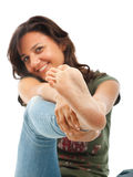 Girl in jeans showing the foot. Stock Photos