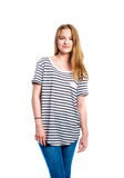 Girl in jeans and striped t-shirt, woman, studio shot. Teenage girl in jeans and striped t-shirt, young woman, studio shot on white background Stock Photos