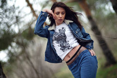 Girl in jeans suit in the forest. Royalty Free Stock Image