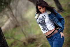 Girl in jeans suit in the forest. Stock Photos