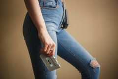 Girl in Jeans with White Audio Cassette. Close up. Concept of Hipsters, Love Retro Music, Dance Party 90s royalty free stock photos