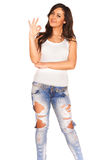 Girl in jeans. On white background Stock Images