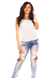 Girl in jeans. On white bckground Stock Image
