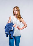 Girl in jeans and white blouse, woman, studio shot Stock Images