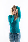 Girl in jeans with the 'who me' look. Girl in jeans with the 'who me' look isolated on white stock photos