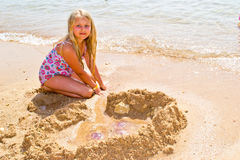 Girl with jellyfish Stock Images