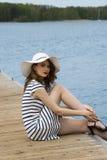 Girl on jetty near lake Royalty Free Stock Photo
