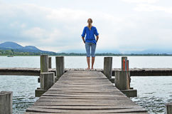 Girl on jetty Stock Photo