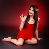 Girl with jewellery  box on red background. Royalty Free Stock Photography