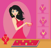 Girl at a jewelry store Royalty Free Stock Photo