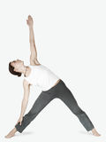 Girl in a joga triangle pose Stock Images