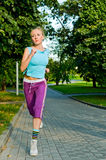 Girl jogging Royalty Free Stock Images