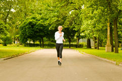 Girl jogging Stock Photos