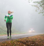 Girl jogging Stock Images