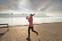 Girl jogging Royalty Free Stock Photography