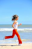 Girl jogging on the beach Royalty Free Stock Images