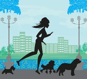 Girl Jogging with Dogs Royalty Free Stock Image
