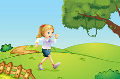 A girl jogging at the hill Stock Photo