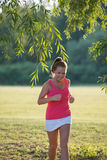 Girl jogging in nature Stock Images