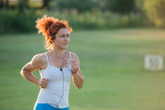 Girl jogging in nature Royalty Free Stock Photos