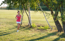 Girl jogging in nature Stock Photography