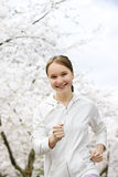 Girl jogging in park royalty free stock photo
