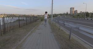 A girl while jogging in park. A girl while jogging in the park stock video footage