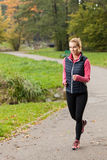 Girl jogging in park Stock Photos