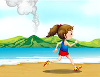 A girl jogging at the seashore Stock Photo