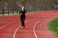 Girl Jogging in a Stadium Royalty Free Stock Photos