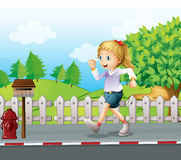 A girl jogging at the street Royalty Free Stock Photos