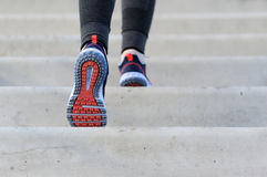 Girl jogging up steps. Royalty Free Stock Images