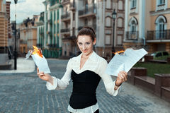 Girl with joy on her face burn documents. Stock Image