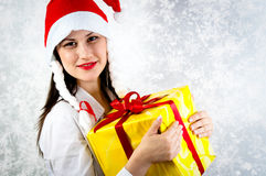 Girl with joyful expression holding her present Royalty Free Stock Image