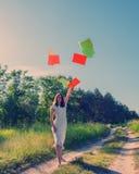 Girl joyfully threw sheets of paper Royalty Free Stock Photo