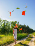 Girl joyfully threw sheets of paper Stock Photo