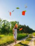Girl joyfully threw sheets of paper Stock Photo