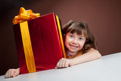 Girl joyously embraces the present Stock Photography