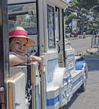 Girl in joyride train Royalty Free Stock Photography