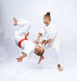 The girl in judogi throws the boy Royalty Free Stock Photography