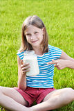 Girl with a jug of milk Stock Photography