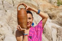 Girl with a jug stock images