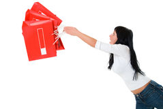 Girl juggle packages. Isolated on white Stock Photo