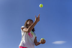 Girl juggles. Stock Images