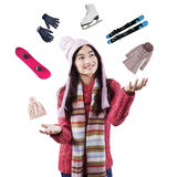 Girl juggling the equipment of winter holiday Stock Images