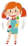 Girl juggling with four balls Royalty Free Stock Photos