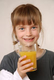 Girl with juice Stock Images