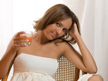 Girl with juice Stock Image